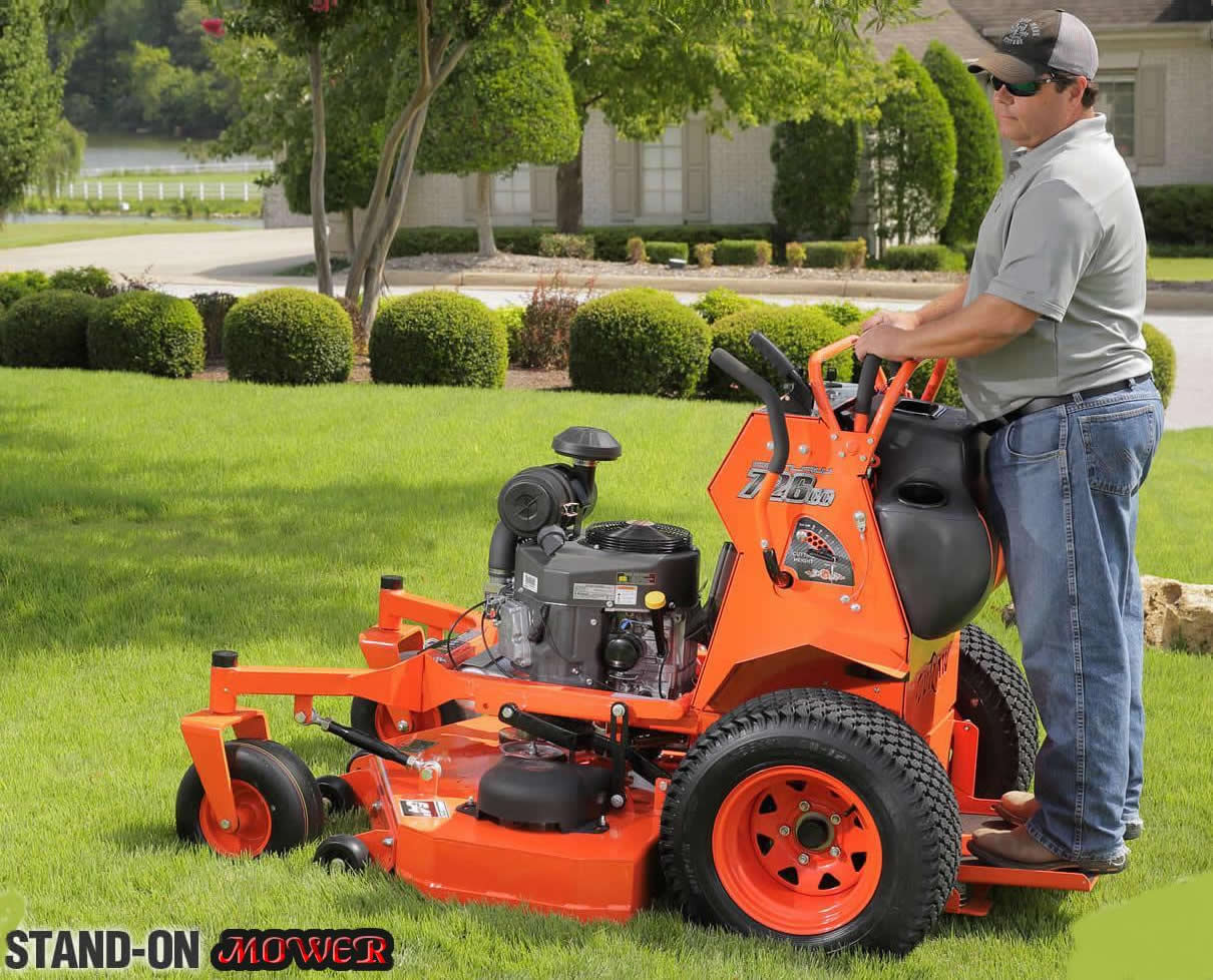 Guy on stand on mower