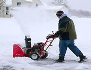 clearing snow with snow blower
