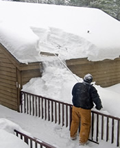 safely using a roof rake to clear snow