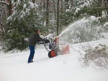 two-stage snowblower on steep path